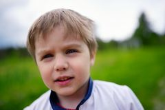 Outdoors closeup portrait of caucasian little boy Stock Images