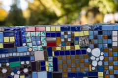 Outdoors colourful mosaic wall at sunset stock image