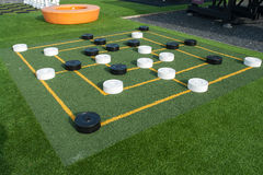 Outdoors draughts checkers board game. Colorful street outdoors draughts checkers board game in a playground stock image
