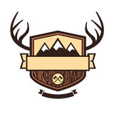 Outdoors emblem. Wood themed outdoors emblem with mountains and antlers stock illustration