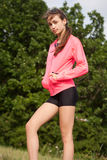 Outdoors exercise in fresh air. Fit young brunette woman doing outdoors exercise in fresh air Stock Images