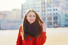 Outdoors fashion portrait of beautiful brunette woman posing on a city street Royalty Free Stock Image