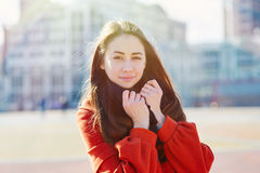 Outdoors fashion portrait of beautiful brunette woman posing on a city street Royalty Free Stock Images