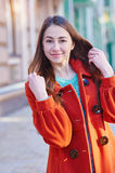 Outdoors fashion portrait of beautiful brunette woman posing on a city street Stock Photography