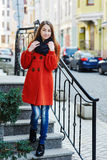 Outdoors fashion portrait of beautiful brunette woman posing on a city street Royalty Free Stock Photos