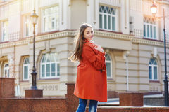 Outdoors fashion portrait of beautiful brunette woman posing on a city street Stock Photo