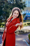 Outdoors fashion portrait of beautiful brunette woman, posing on a city street Stock Photo