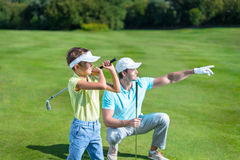 Outdoors. Father and son playing golf Stock Photography