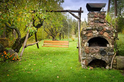Outdoors fireplace and swing stock photos