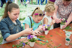 Outdoors floristic workshop. Zaporizhia/Ukraine- May 28, 2017: Charity Family festival:  teen girls participating at floristic workshop, learning to arrange Stock Photos