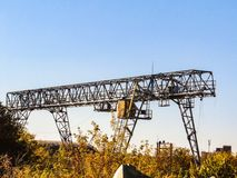 Free Outdoors Gantry Crane On A Blue Sky Background Royalty Free Stock Photo - 140782865