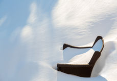 Outdoors garden chair buried in snow drift Stock Image