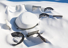 Outdoors garden table and chairs buried in snow drift Stock Images