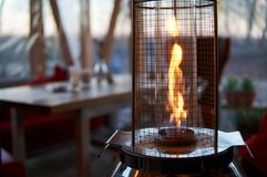 Outdoors gas heater. Gas flame heater typically used on outdoor patios and restaurants royalty free stock image