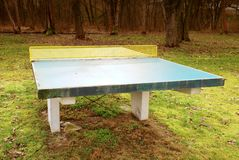 Outdoors green  concrete ping pong table in camp Royalty Free Stock Photo