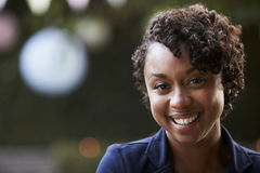 Outdoors Head And Shoulders Portrait Of Smiling Young Woman Stock Photography