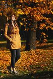Outdoors lifestyle close up portrait of charming young woman wearing a wreath of autumn leaves. walking on the autumn. Park royalty free stock photo