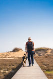 Outdoors lifestyle image of travelling man with cute dog. Tourism concept. Stock Images
