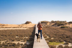 Outdoors lifestyle image of travelling man with cute dog. Tourism concept. Royalty Free Stock Photo