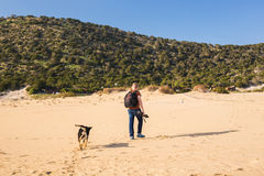 Outdoors lifestyle image of travelling man with cute dog. Tourism concept. Royalty Free Stock Photos