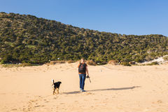 Outdoors lifestyle image of travelling man with cute dog. Tourism and pet concept. Stock Image