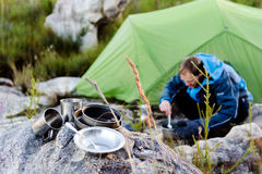 Outdoors man cooking Royalty Free Stock Images