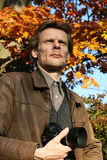 Outdoors Man in the Fall. A rugged man in the countryside out for a country walk with his camera. Man, people, middle, age royalty free stock photos