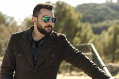 Outdoors man portrait with beard and sunglasses Stock Image