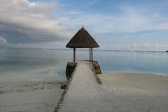 Outdoors pavilion sand beach and beautiful cloud Maldive island resort royalty free stock image