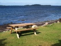 Outdoors Picnic table by the beach Royalty Free Stock Image