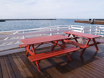 Outdoors Picnic tables by the sea Royalty Free Stock Photo