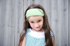 Outdoors portrait of adorable smiling child girl Stock Image