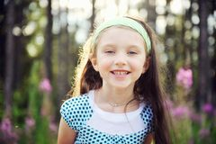 Outdoors portrait of adorable smiling child girl Royalty Free Stock Photography