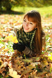Outdoors portrait of autumn happy girl in park Royalty Free Stock Photography