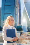 Outdoors portrait of beautiful business woman on skyscrapers background Royalty Free Stock Photos