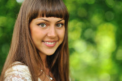 Outdoors portrait of a beautiful girl face over nature backgroun Stock Photo