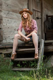 Red haired cowgirl Stock Photo