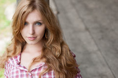 Red haired cowgirl Stock Images