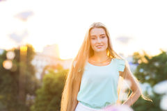 Outdoors portrait of beautiful young blond woman Royalty Free Stock Image