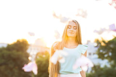 Outdoors portrait of beautiful young blond woman Stock Photos