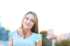 Outdoors portrait of beautiful young blond woman Royalty Free Stock Images