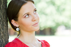 Outdoors portrait of beautiful young brunette. Stock Images