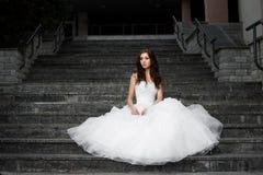 Beautiful young woman in wedding dress Stock Photos