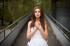Beautiful young woman in wedding dress Stock Photo