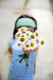Outdoors portrait of a child girl with daisies Royalty Free Stock Photos