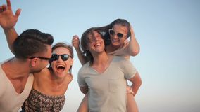 Outdoors Portrait of Happy Young Group of Friends Enjoying Beach Holiday. Two Couples Laughing near the Sea During stock video
