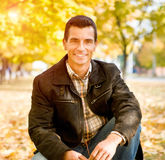 Outdoors portrait of happy young man Royalty Free Stock Image