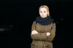 Outdoors portrait of naughty young beautiful blonde hipster woman in scarf and olive parka with a dreadlocks bun hairstyle Stock Images