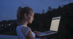 Outdoors portrait of pretty blonde woman with laptop computer Royalty Free Stock Photo