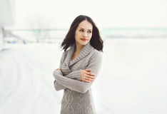 Outdoors portrait of pretty young woman in knitted sweater Royalty Free Stock Photography